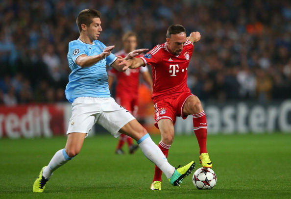 MANCHESTER, ENGLAND - OCTOBER 02:  Franck Ribery of Muenchen battles with Matija Nastasic of Manchester City during the UEFA Champions League Group D match between Manchester City and FC Bayern Muenchen at Etihad Stadium on October 2, 2013 in Manchester, England.  (Photo by Julian Finney/Getty Images)