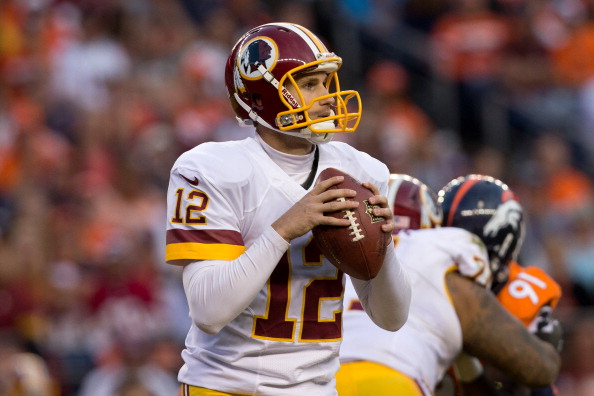 DENVER, CO - OCTOBER 27:  Quarterback Kirk Cousins #12 of the Washington Redskins in action against the Denver Broncos at Sports Authority Field Field at Mile High on October 27, 2013 in Denver, Colorado. The Broncos defeated the Redskins 45-21.  (Photo by Justin Edmonds/Getty Images)