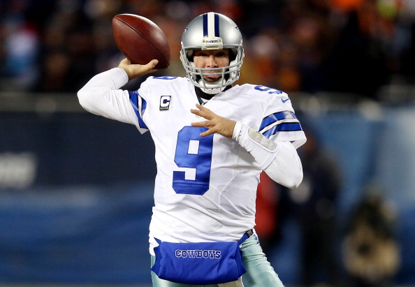 CHICAGO, IL - DECEMBER 09: Quarterback Tony Romo #9 of the Dallas Cowboys passes against the Chicago Bears during a game at Soldier Field on December 9, 2013 in Chicago, Illinois.  (Photo by Jonathan Daniel/Getty Images)