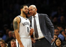 Dec 10, 2013; Brooklyn, NY, USA; Brooklyn Nets point guard Deron Williams (8) and head coach Jason Kidd in the second half of NBA game against the Boston Celtics at Barclays Center. Mandatory Credit: Noah K. Murray-USA TODAY Sports