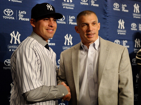 NEW YORK, NY - DECEMBER 13:  Centerfielder Jacoby Ellsbury and New York Yankees Manager Joe Girardi stand for a photo during Ellsbury's introductory press conference at Yankee Stadium on December 13, 2013 in the Bronx borough of New York City.  (Photo by Maddie Meyer/Getty Images)
