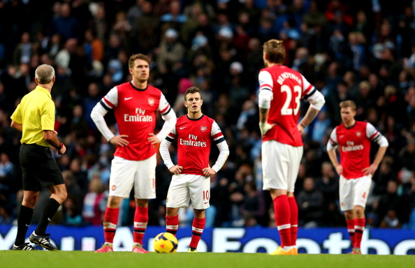 MANCHESTER, ENGLAND - DECEMBER 14: Aaron Ramsey, Jack Wilshere and Nicklas Bendtner of Arsenal stand dejected after fifth Man City goal during the Barclays Premier League match between Manchester City and Arsenal at Etihad Stadium on December 14, 2013 in Manchester, England. (Photo by Clive Brunskill/Getty Images)