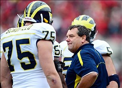 Nov 24, 2012; Columbus, OH, USA; Michigan Wolverines head coach Brady Hoke talks to offensive linesman Michael Schofield (75) in the first quarter against the Ohio State Buckeyes at Ohio Stadium. Mandatory Credit: Andrew Weber-USA TODAY Sports