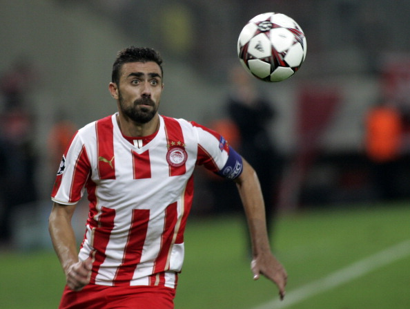 ATHENS, GREECE - SEPTEMBER 17:  Giannis Maniatis of Olympiacos FC in action during the UEFA Champions League group stage match between Olympiacos FC and Paris Saint-Germain FC held on September 17, 2013 at the Georgios Karaiskakis Stadium in Athens, Greece. (Photo by Milos Bicanski/EuroFootball/Getty Images)