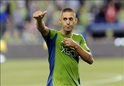 Aug 25, 2013; Seattle, WA, USA; Seattle Sounders FC forward Clint Dempsey (2) gives thumbs up to the fans after the game between the Seattle Sounders FC and the Portland Timbers at CenturyLink Field. Seattle defeated Portland 1-0. Mandatory Credit: Steven Bisig-USA TODAY Sports