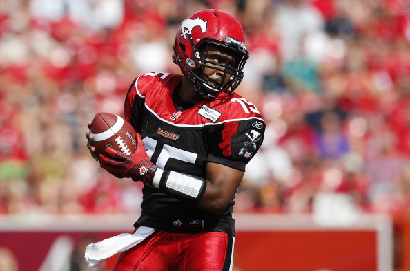 CALGARY, AB, CANADA - SEPTEMBER 2: Quarterback Kevin Glenn #15 of the Calgary Stampeders looks to throw a pass against the Edmonton Eskimos in the first half of their CFL football game September 2, 2013 in Calgary, Alberta, Canada. (Photo by Todd Korol/Getty Images)