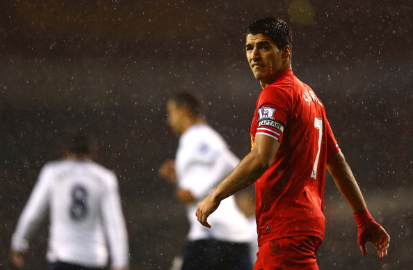 LONDON, ENGLAND - DECEMBER 15:  Captain Luis Suarez of Liverpool looks on through the rain during the Barclays Premier League match between Tottenham Hotspur and Liverpool at White Hart Lane on December 15, 2013 in London, England.  (Photo by Paul Gilham/Getty Images)