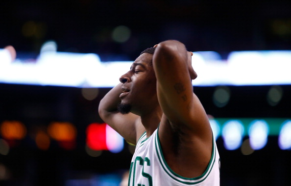 BOSTON, MA - DECEMBER 16: Jordan Crawford #27 of the Boston Celtics reacts following a foul call against the Minnesota Timberwolves during the game at TD Garden on December 16, 2013 in Boston, Massachusetts. NOTE TO USER: User expressly acknowledges and agrees that, by downloading and or using this photograph, User is consenting to the terms and conditions of the Getty Images License Agreement.  (Photo by Jared Wickerham/Getty Images)