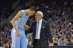 Mar 24, 2013; Kansas City, MO, USA; North Carolina Tar Heels head coach Roy Williams (right) talks with forward Brice Johnson(11) in the first half against the Kansas Jayhawks during the third round of the NCAA basketball tournament at the Sprint Center. Mandatory Credit: Peter G. Aiken-USA TODAY Sports
