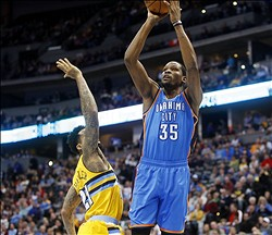 Dec 17, 2013; Denver, CO, USA; Oklahoma City Thunder forward Kevin Durant (35) shoots the ball during the first half against the Denver Nuggets at Pepsi Center. Mandatory Credit: Chris Humphreys-USA TODAY Sports