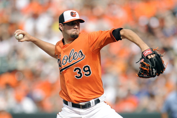 BALTIMORE, MD - JULY 13:  Jason Hammel #39 of the Baltimore Orioles pitches during a baseball game against the Toronto Blue Jays on July 13, 2013 at Oriole Park at Camden Yards in Baltimore, Maryland.  (Photo by Mitchell Layton/Getty Images)