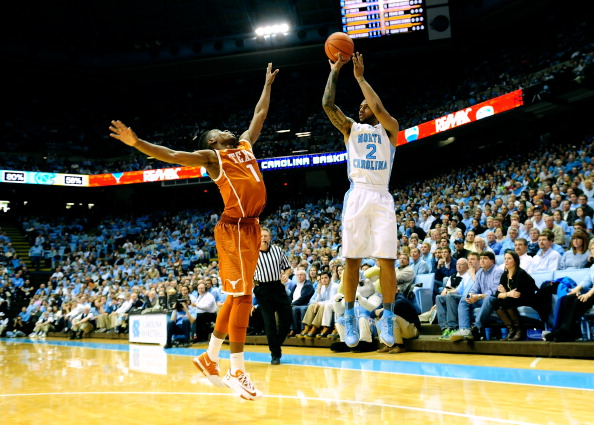 CHAPEL HILL, NC - DECEMBER 18:  Leslie McDonald #2 of the North Carolina Tar Heels launches a 3-point shot over Isaiah Taylor #1 of the Texas Longhorns during their game at the Dean Smith Center on December 18, 2013 in Chapel Hill, North Carolina. Texas won 86-83.  (Photo by Grant Halverson/Getty Images)