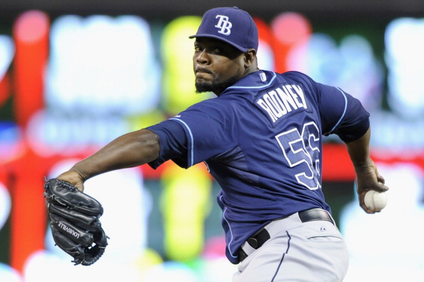 MINNEAPOLIS, MN - SEPTEMBER 13: Fernando Rodney #56 of the Tampa Bay Rays delivers a pitch against the Minnesota Twins during the ninth inning of the game on September 13, 2013 at Target Field in Minneapolis, Minnesota. The Rays defeated the Twins 3-0. (Photo by Hannah Foslien/Getty Images)