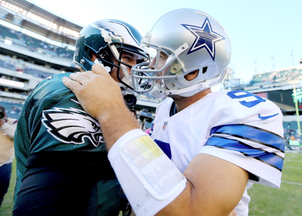 PHILADELPHIA, PA - OCTOBER 20:  Tony Romo #9 of the Dallas Cowboys talks with Matt Barkley #2 of the Philadelphia Eagles after the game on October 20, 2013 at Lincoln Financial Field in Philadelphia, Pennslyvania.The Dallas Cowboys defeated the Philadelphia Eagles 17-3.  (Photo by Elsa/Getty Images)
