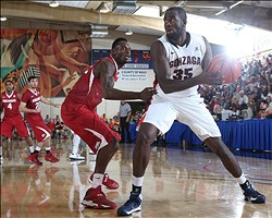 Nov 27, 2013; Lahaina, HI, USA; Gonzaga Bulldogs forward Sam Dower Jr. (35) dribbles the ball around Arkansas Razorbacks during the final round of the EA Sports Maui Invitational at the Lahaina Civic Center. Mandatory Credit: Brian Spurlock-USA TODAY Sports