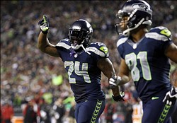 Sep 15, 2013; Seattle, WA, USA; Seattle Seahawks running back Marshawn Lynch (24) celebrates after rushing for a touchdown against the San Francisco 49ers during the third quarter at CenturyLink Field. Mandatory Credit: Joe Nicholson-USA TODAY Sports