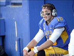 Oct 26, 2013; San Jose, CA, USA; San Jose State Spartans quarterback David Fales (10) talks with coaches from the bench during the second quarter against the Wyoming Cowboys at Spartan Stadium. San Jose State won 51-44. Mandatory Credit: Bob Stanton-USA TODAY Sports