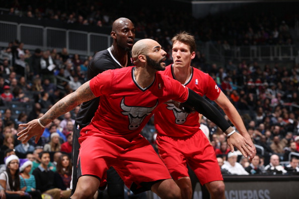 BROOKLYN, NY - DECEMBER 25:  Carlos Boozer #5 of the Chicago Bulls boxes out Kevin Garnett #2 of the Brooklyn Nets during a game on December 25, 2013 at Barclays Center in Brooklyn, New York. NOTE TO USER: User expressly acknowledges and agrees that, by downloading and or using this Photograph, user is consenting to the terms and conditions of the Getty Images License Agreement. Mandatory Copyright Notice: Copyright 2013 NBAE (Photo by David Sherman/NBAE via Getty Images)