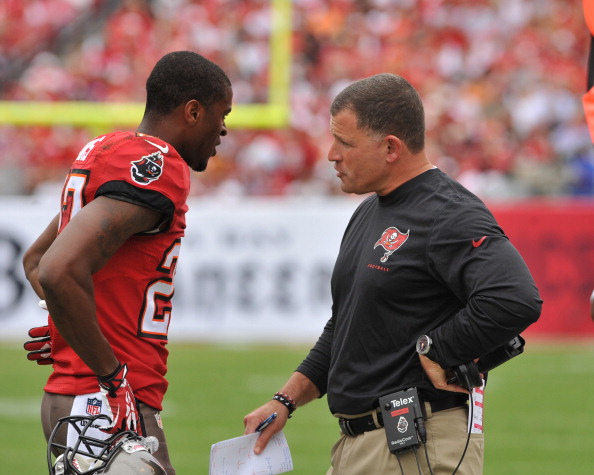 TAMPA, FL -  DECEMBER 15:  Coach Greg Schiano of the Tampa Bay Buccaneers talks with cornerback Johnthan Banks #27 during play against the San Francisco 49ers December 15, 2013 at Raymond James Stadium in Tampa, Florida. The 49ers won 33 - 14  (Photo by Al Messerschmidt/Getty Images)