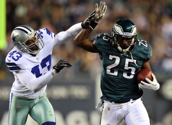 PHILADELPHIA, PA - NOVEMBER 11:  Gerald Sensabaugh #43 of the Dallas Cowboys shoves  LeSean McCoy #25 of the Philadelphia Eagles out of bounds on November 11, 2012 at Lincoln Financial Field in Philadelphia, Pennsylvania.The Dallas Cowboys defeated the Philadelphia Eagles 38-23.  (Photo by Elsa/Getty Images)