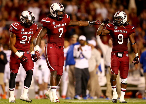 COLUMBIA, SC - NOVEMBER 16:  Jadeveon Clowney #7 of the South Carolina Gamecocks celebrates a defensive stop with teammates Marcquis Roberts #21 and Sharrod Golightly #9 during their game against the Florida Gators at Williams-Brice Stadium on November 16, 2013 in Columbia, South Carolina.  (Photo by Streeter Lecka/Getty Images)