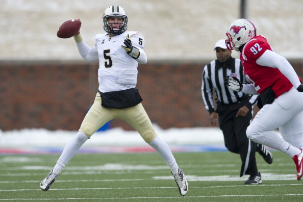 DALLAS, TX - DECEMBER 7: Blake Bortles #5 of the Central Florida Knights drops back to pass against the SMU Mustangs on December 7, 2013 at Gerald J. Ford Stadium in Dallas, Texas.  (Photo by Cooper Neill/Getty Images)