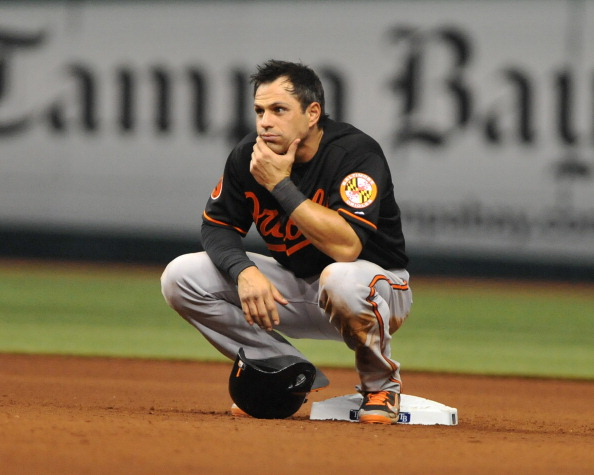 ST. PETERSBURG, FL - SEPTEMBER 20:  Infielder Brian Roberts #1 of the Baltimore Orioles crouches at 2nd base while the Tampa Bay Rays change pitchers September 20, 2013 at Tropicana Field in St. Petersburg, Florida. (Photo by Al Messerschmidt/Getty Images)