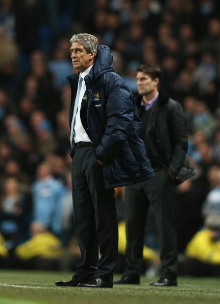 MANCHESTER, ENGLAND - DECEMBER 01:  Manuel Pellegrini (L), manager of Manchester City looks on with Michael Laudrup, manager of Swansea City during the Barclays Premier League match between Manchester City and Swansea City at Etihad Stadium on December 1, 2013 in Manchester, England.  (Photo by Clive Brunskill/Getty Images)