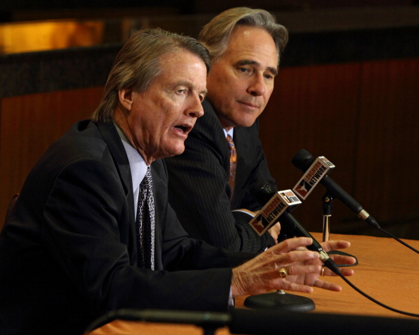 AUSTIN, TX - DECEMBER 15: University of Texas at Austin president Bill Powers, left, and Athletic Director Steve Patterson answer questions regarding the resignation of football coach Mack Brown on December 15, 2013 in Austin, Texas. Moments earlier, Brown announced he will step down as coach after the Valero Alamo Bowl game against Oregon on December 30. (Photo by Erich Schlegel/Getty Images)