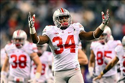 Dec 7, 2013; Indianapolis, IN, USA; Ohio State Buckeyes running back Carlos Hyde (34) pumps up the crowd prior to the 2013 Big 10 Championship game against the Michigan State Spartans at Lucas Oil Stadium. Mandatory Credit: Andrew Weber-USA TODAY Sports
