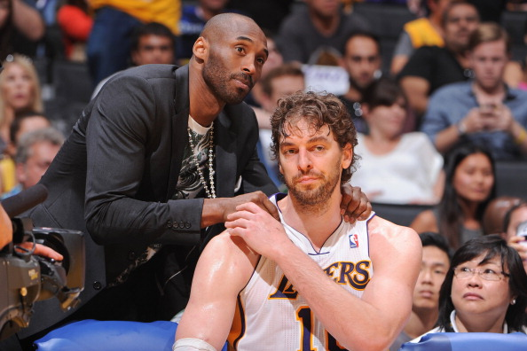 LOS ANGELES, CA - APRIL 28: Kobe Bryant #24 of the Los Angeles Lakers greets teammate Pau Gasol #16 on the bench as their team plays against the San Antonio Spurs in Game Four of the Western Conference Quarterfinals during the 2013 NBA Playoffs at Staples Center on April 28, 2013 in Los Angeles, California.  NOTE TO USER: User expressly acknowledges and agrees that, by downloading and/or using this Photograph, user is consenting to the terms and conditions of the Getty Images License Agreement. Mandatory Copyright Notice: Copyright 2013 NBAE (Photo by Andrew D. Bernstein/NBAE via Getty Images)