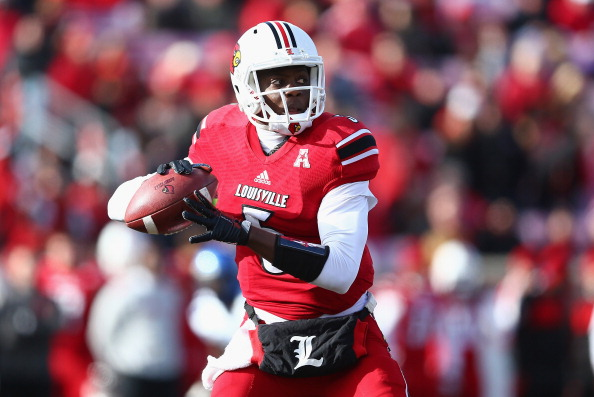 LOUISVILLE, KY - NOVEMBER 23:  Teddy Bridgewater #5 of the Louisville Cardinals throws the ball during the game against the Memphis Tigers at Papa John's Cardinal Stadium on November 23, 2013 in Louisville, Kentucky.  (Photo by Andy Lyons/Getty Images)