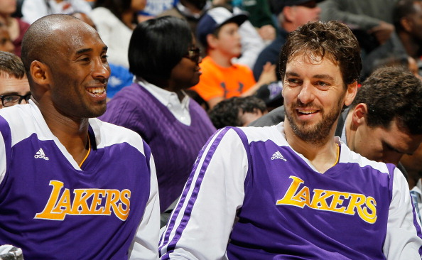 ATLANTA, GA - DECEMBER 16:  Kobe Bryant #24 and Pau Gasol #16 of the Los Angeles Lakers enjoy a laugh during the first half against the Atlanta Hawks at Philips Arena on December 16, 2013 in Atlanta, Georgia.  NOTE TO USER: User expressly acknowledges and agrees that, by downloading and or using this photograph, User is consenting to the terms and conditions of the Getty Images License Agreement.  (Photo by Kevin C. Cox/Getty Images)