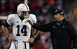 Nov 30, 2013; Madison, WI, USA; Penn State Nittany Lions head coach Bill O'Brien talks to quarterback Christian Hackenberg (14) during the game with the Wisconsin Badgers at Camp Randall Stadium. Penn State defeated Wisconsin 31-24. Mandatory Credit: Mary Langenfeld-USA TODAY Sports