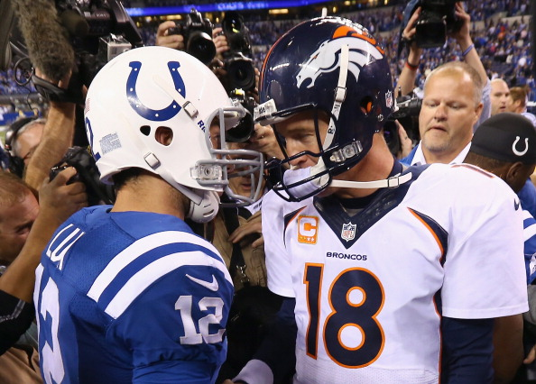 INDIANAPOLIS, IN - OCTOBER 20:  Andrew Luck #12 of the Indianapolis Colts and Peyton Manning #18 of the Denver Broncos meet after the game at Lucas Oil Stadium on October 20, 2013 in Indianapolis, Indiana. The Colts won 39-33.  (Photo by Andy Lyons/Getty Images)