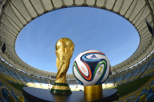 RIO DE JANEIRO, BRAZIL - DECEMBER 03:  A general view of Brazuca and the FIFA World Cup Trophy at the Maracana before the adidas Brazuca launch at Parque Lage on December 3, 2013 in Rio de Janeiro, Brazil. Brazuca is the Official Match Ball for the FIFA World Cup 2014 Brazil. Tonight adidas revealed brazuca to the world in the stunning setting of Parque Lage in Rio de Janeiro. The reveal was part of a spectacular light projection supported by global footballers Seedorf, Hernane and FIFA World Cup Winner Cafu. Hundreds of guests and celebrities were treated to this one off experience, which launched the Official FIFA World Cup Ball for Brazil 2014. For more information visit: news.adidas.com/worldcupOMB  (Photo by Alexandre Loureiro/Getty Images for adidas)