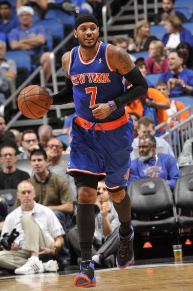 ORLANDO, FL - DECEMBER 23: Carmelo Anthony #7 of the New York Knicks dribbles up the court against the Orlando Magic during the game on December 23, 2013 at Amway Center in Orlando, Florida. NOTE TO USER: User expressly acknowledges and agrees that, by downloading and or using this photograph, User is consenting to the terms and conditions of the Getty Images License Agreement. Mandatory Copyright Notice: Copyright 2013 NBAE  (Photo by Fernando Medina/NBAE via Getty Images)