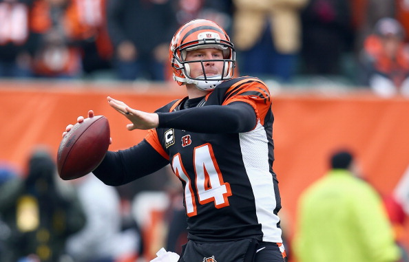 CINCINNATI, OH - DECEMBER 29:  Andy Dalton #14 of the Cincinnati Bengals throws a pass during the NFL game against the Baltimore Ravens  at Paul Brown Stadium on December 29, 2013 in Cincinnati, Ohio.  (Photo by Andy Lyons/Getty Images)