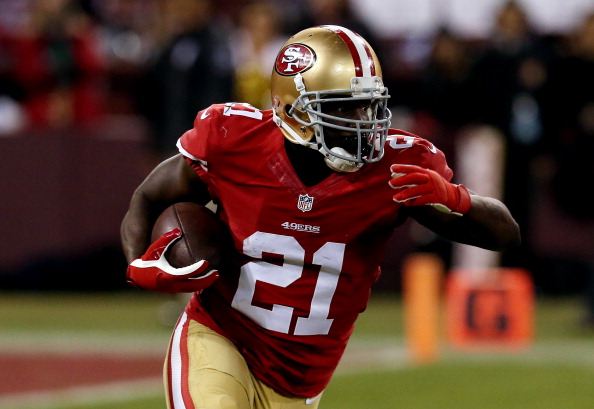 SAN FRANCISCO, CA - DECEMBER 23:  Running back Frank Gore #21 of the San Francisco 49ers carries the ball against the Atlanta Falcons during a game at Candlestick Park on December 23, 2013 in San Francisco, California.  (Photo by Stephen Dunn/Getty Images)