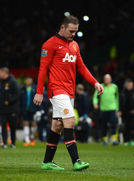 MANCHESTER, ENGLAND - JANUARY 01:  Wayne Rooney of Manchester United walks off at the end of the Barclays Premier League match between Manchester United and Tottenham Hotspur at Old Trafford on January 1, 2014 in Manchester, England.  (Photo by Michael Regan/Getty Images)