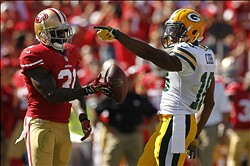 Sep 8, 2013; San Francisco, CA, USA; Green Bay Packers wide receiver Randall Cobb (18) reacts after picking up a first down next to San Francisco 49ers safety Donte Whitner (31) in the third quarter at Candlestick Park. The 49ers defeated the Packers 34-28. Mandatory Credit: Cary Edmondson-USA TODAY Sports