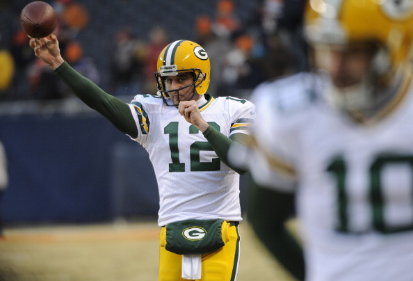 CHICAGO, IL - DECEMBER 29: Aaron Rodgers #12 of the Green Bay Packers warms up before a game against the Chicago Bears on December 29, 2013 at Soldier Field in Chicago, Illinois.  (Photo by David Banks/Getty Images)