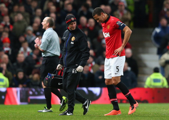 MANCHESTER, ENGLAND - JANUARY 05:  Rio Ferdinand of Manchester United goes off with an injury during the FA Cup with Budweiser Third round match between Manchester United and Swansea City at Old Trafford on January 5, 2014 in Manchester, England.  (Photo by Alex Livesey/Getty Images)