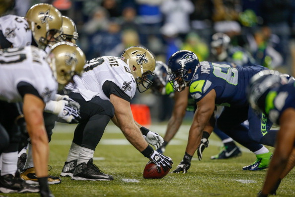 SEATTLE, WA - DECEMBER 02: Center Brian de la Puente of the New Orleans Saints prepares to hike the ball against the Seattle Seahawks at CenturyLink Field on December 2, 2013 in Seattle, Washington. (Photo by Otto Greule Jr/Getty Images)