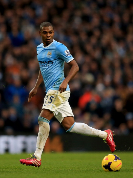 MANCHESTER, ENGLAND - DECEMBER 14:  Fernandinho of Manchester City in action during the Barclays Premier League match between Manchester City and Arsenal at Etihad Stadium on December 14, 2013 in Manchester, England.  (Photo by Richard Heathcote/Getty Images)