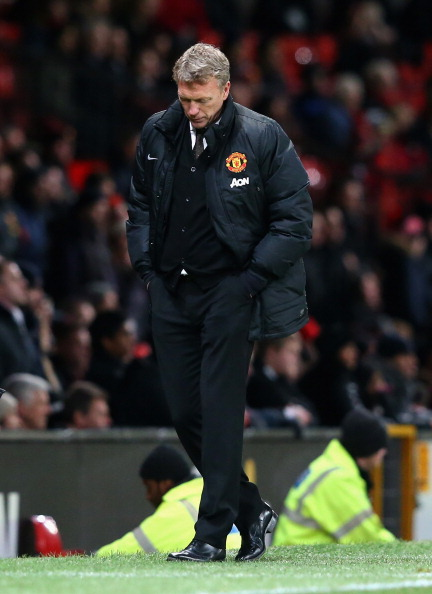 MANCHESTER, ENGLAND - JANUARY 05:  Manchester United manager David Moyes reacts during the FA Cup with Budweiser Third round match between Manchester United and Swansea City at Old Trafford on January 5, 2014 in Manchester, England.  (Photo by Alex Livesey/Getty Images)