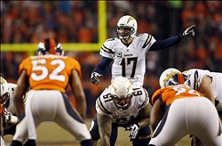Dec 12, 2013; Denver, CO, USA; San Diego Chargers quarterback Philip Rivers (17) during the first half against the Denver Broncos at Sports Authority Field at Mile High. Mandatory Credit: Chris Humphreys-USA TODAY Sports