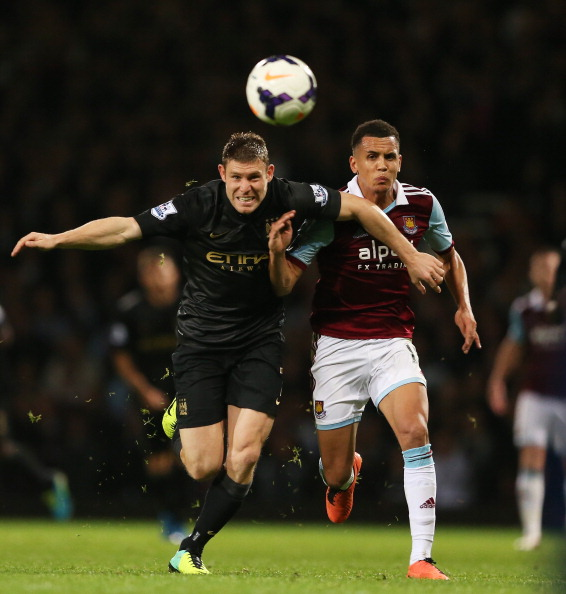 LONDON, ENGLAND - OCTOBER 19:  James Milner of Manchester City and Ravel Morrison of West Ham compete for the ball during the Barclays Premier League match between West Ham United and Manchester City at Boleyn Ground on October 19, 2013 in London, England.  (Photo by Warren Little/Getty Images)