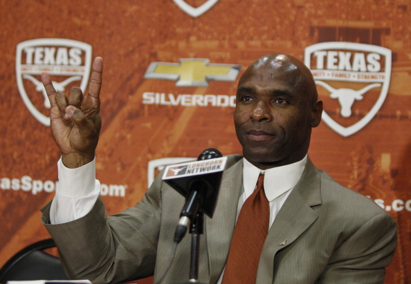 AUSTIN, TX - JANUARY 6: The University of Texas Longhorns new head football coach Charlie Strong from Louisville flashes the 'Hook 'Em Horns' sign after being introduced during a press conference January 6, 2014 at Darrell K. Royal-Texas Memorial Stadium in Austin, Texas.  (Photo by Erich Schlegel/Getty Images)