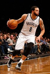 Jan 4, 2014; Brooklyn, NY, USA;  Brooklyn Nets point guard Deron Williams (8) drives the lane during the third quarter against the Cleveland Cavaliers at Barclays Center. Brooklyn Nets won 89-82.  Mandatory Credit: Anthony Gruppuso-USA TODAY Sports
